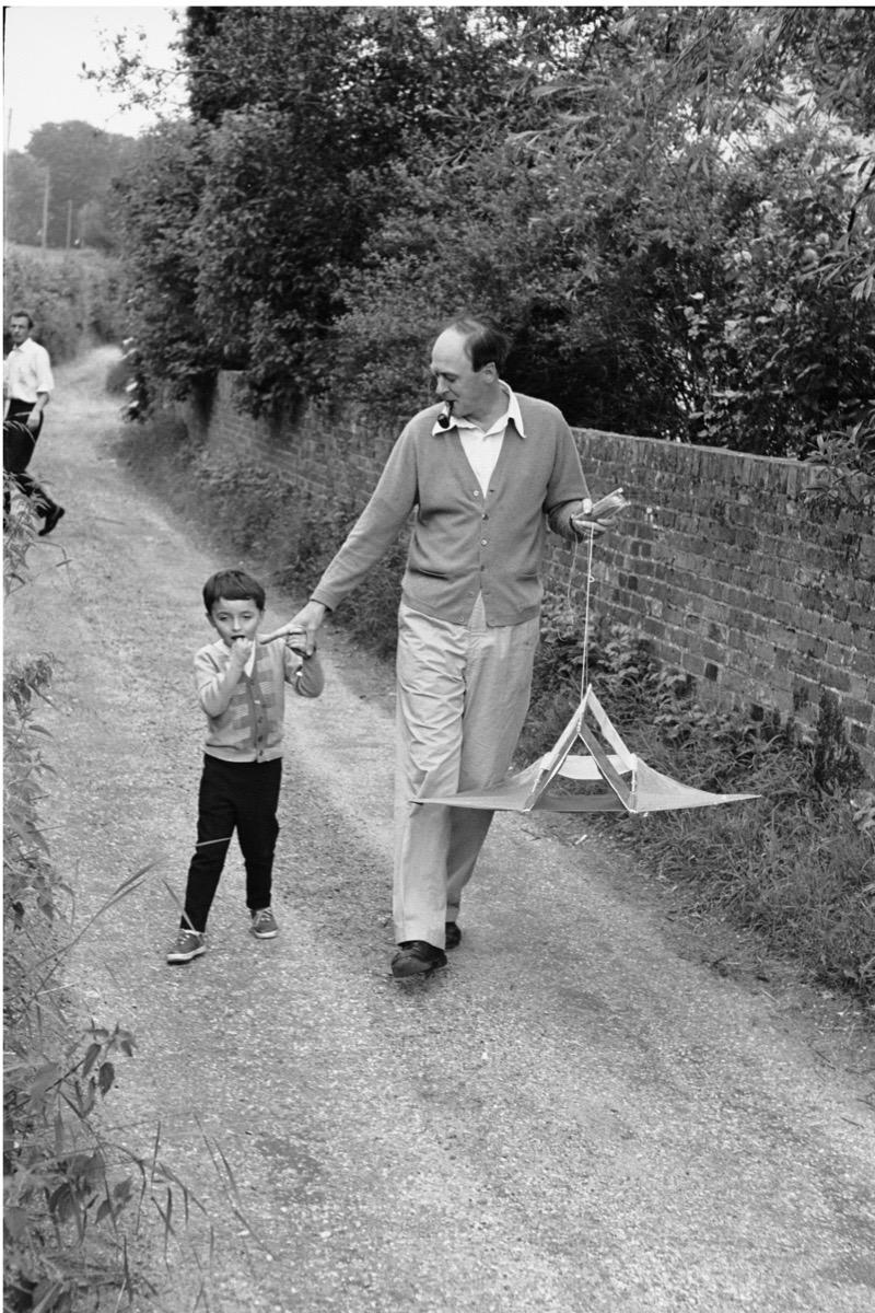 Subject: Roald Dahl with sun walking down road. United Kingdom 1965 Photographer- Leonard McCombe Time Inc Owned Merlin-1182032
