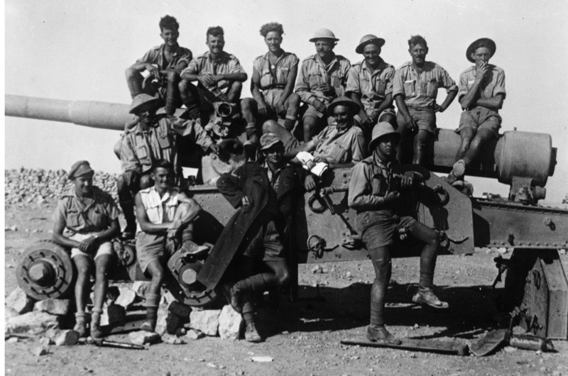 circa 1942:  Men of the 7th British Armoured Division, known as the Desert Rats, sitting on a field gun before the fall of Tobruk in the North African Campaign.  (Photo by Hulton Archive/Getty Images)