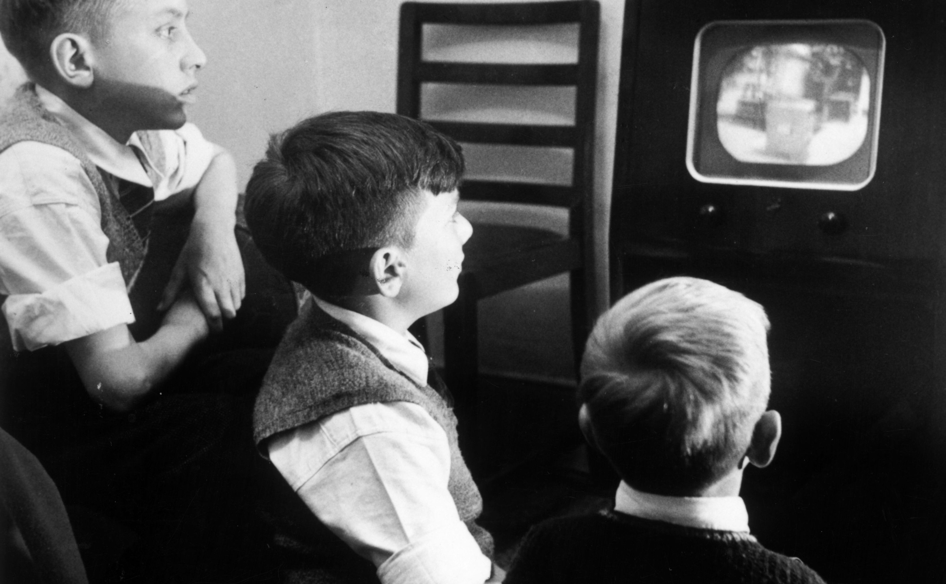 Boys watching TV in the 1950s