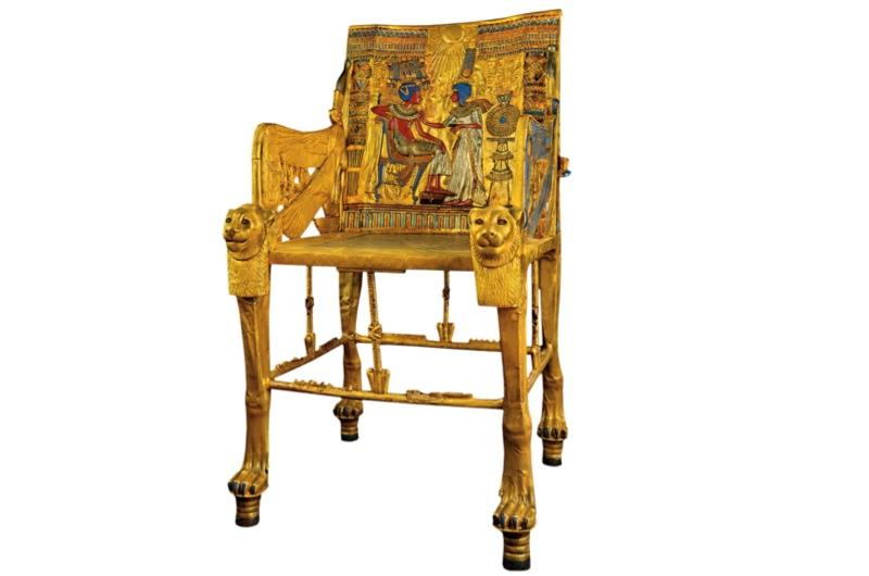 Made of wood and gilded or sheathed in sheets of gold, the chair is covered in intricate decoration - coloured glass and semiprecious stones.