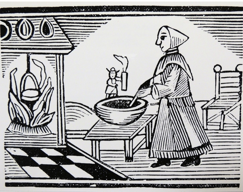 The Famous History of Tom Thumb'' Tom holds a candle so his mother can see to cook. Late eighteenth century woodcut. (Photo by, Universal History Archive/UIG via Getty Images)