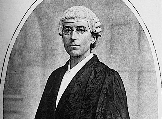 23 May 1922 --- Miss Ivy Williams, B.C.I. M.A. and lecturer at Oxford, first Englishwoman to be called to the bar , and who is required to wear the cotume adopted by all English barristers.  Miss Williams is pictures in the White Wig, completley covering the head, barristers gown and white waist. --- Image by © Bettmann/CORBIS