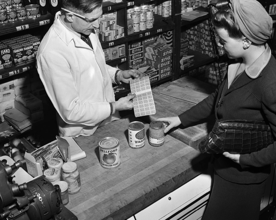 A woman purchasing canned goods in the 1940s using rationing tokens. (Charles Phelps Cushing/ClassicStock/Getty Images)