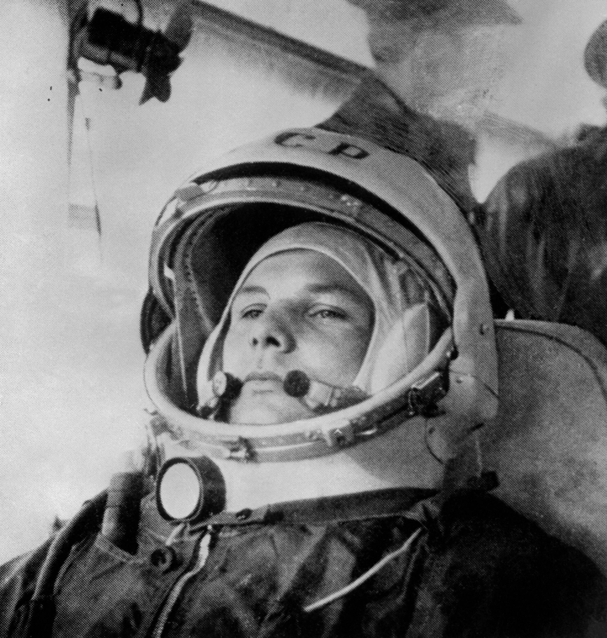 """(FILES) This file photo dated 12 April 1961 shows Yuri Gagarin at the age of 27 before boarding a Soviet Vostok I spaceship at the Baikonur rockets launch pad shortly before becoming the first man to travel in space. A court met 07 September 2007 in Moscow in a case brought by Gagarin's two daughters who are suing Moscow-based film company Central Partnership, for allegedly misusing Gagarin's name and misrepresenting his life in the tragi-comic feature film """"Gagarin's Grandson,"""" the company said. The film deals only tangentially with Gagarin, who died in 1968 and has had near saint-like status in Russia since his 1961 space flight. AFP PHOTO / STR (Photo credit should read -/AFP/Getty Images)"""
