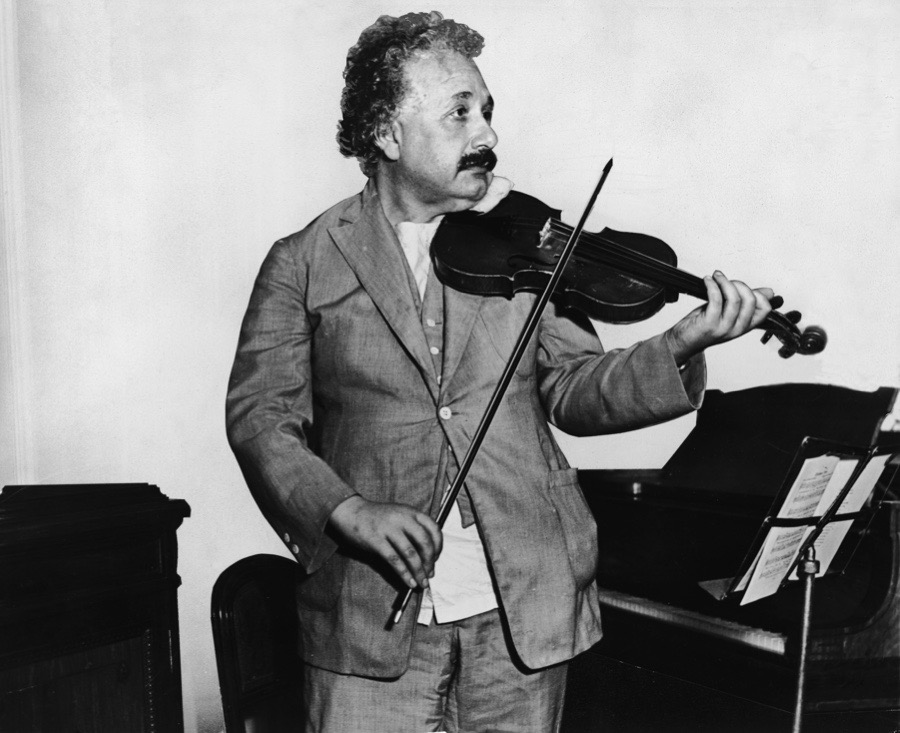 This heavily retouched photograph shows German-Swiss-American mathematical physicist Albert Einstein (1879 - 1955) as he plays a violin in the music room of the S.S. Belgenland en route to California, 1931. (Photo by Keystone/Getty Images)