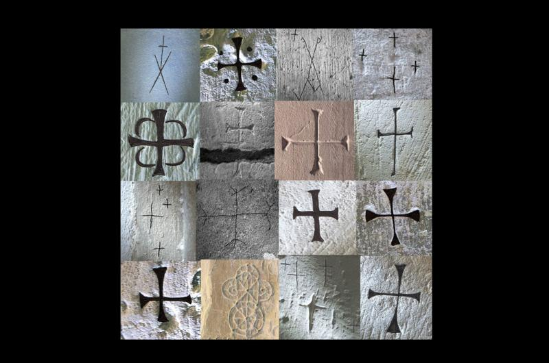 Graffiti crosses found in churches