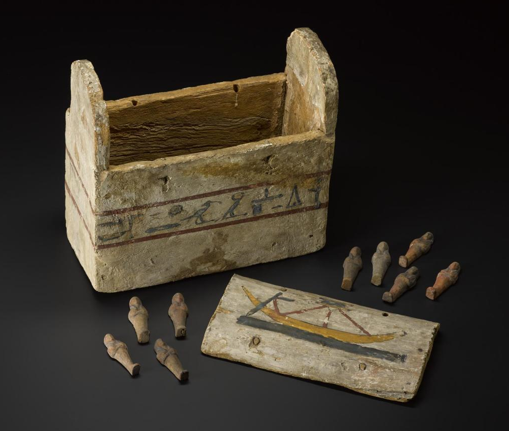 Clay shabtis and wooden shabti box, from Thebes