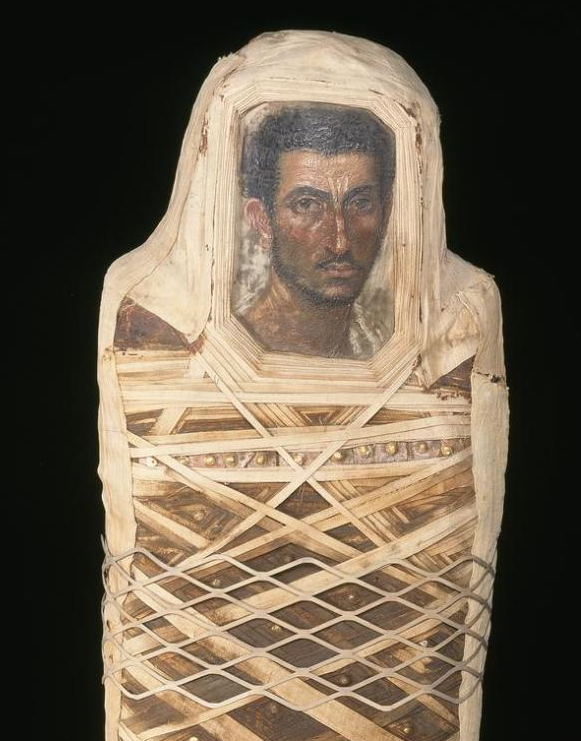 Mummified man with a portrait-board fitted over the face, excavated at Hawara c80–120 AD