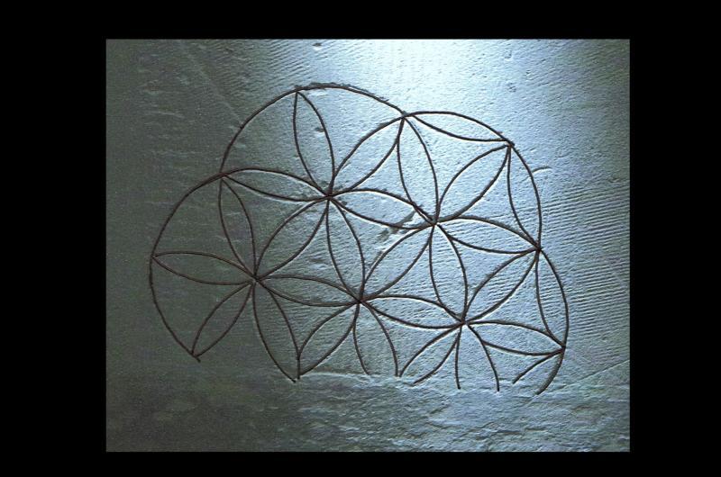 Graffiti found in a daisy wheel design.