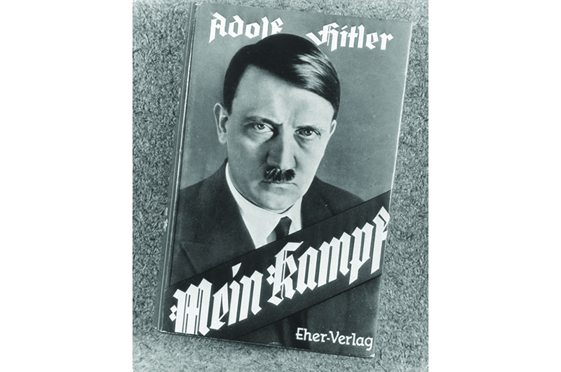 UNSPECIFIED - 1924:  Front jacket to Adolf Hitler's autobiography MEIN KAMPF with photo of Hitler.  (Photo by Pix Inc./Pix Inc./Time & Life Pictures/Getty Images)