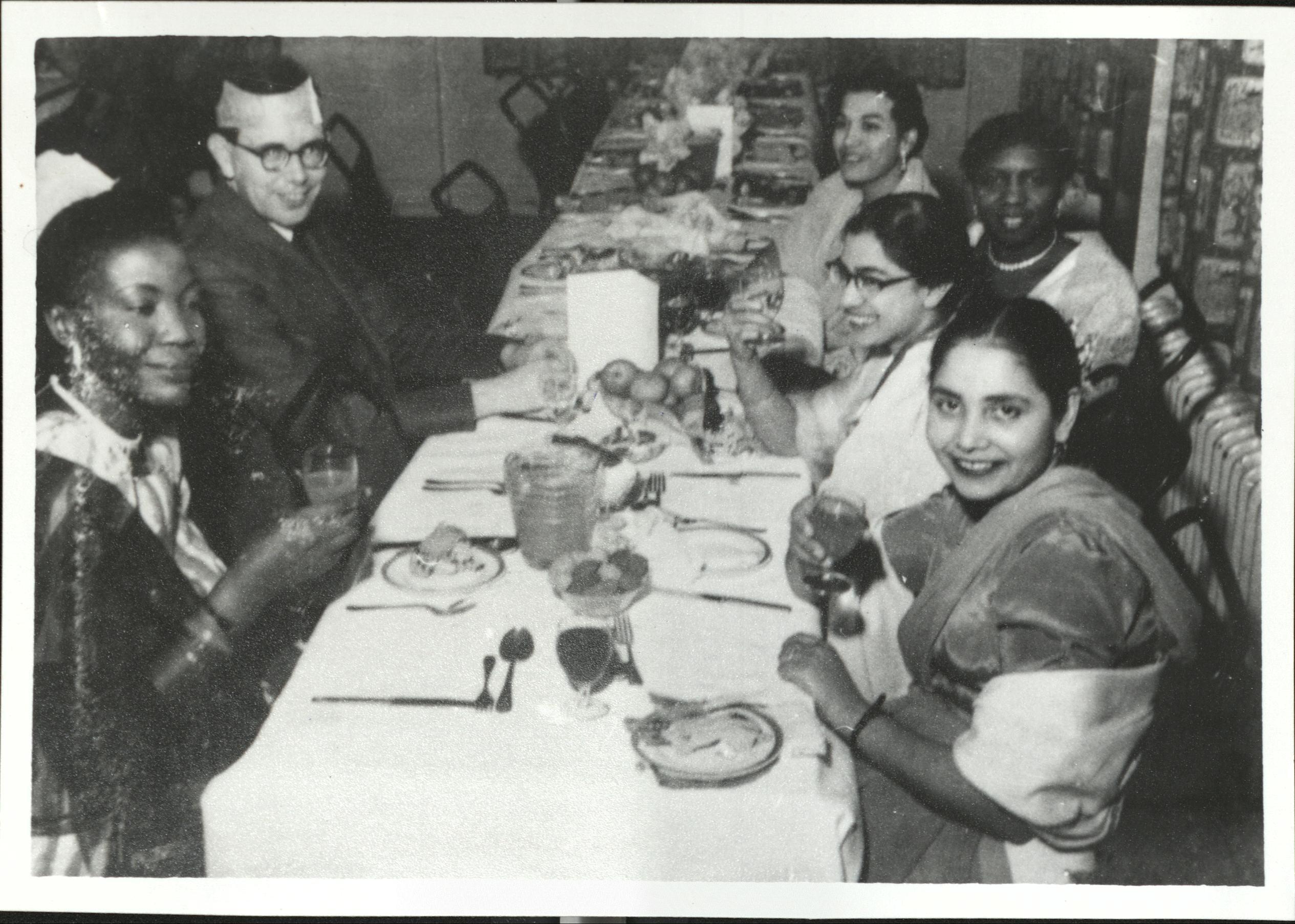 A photograph of Uma Halder at Christmas dinner, from the exhibition exhibition Hidden in plain sight: Celebrating nursing diversity