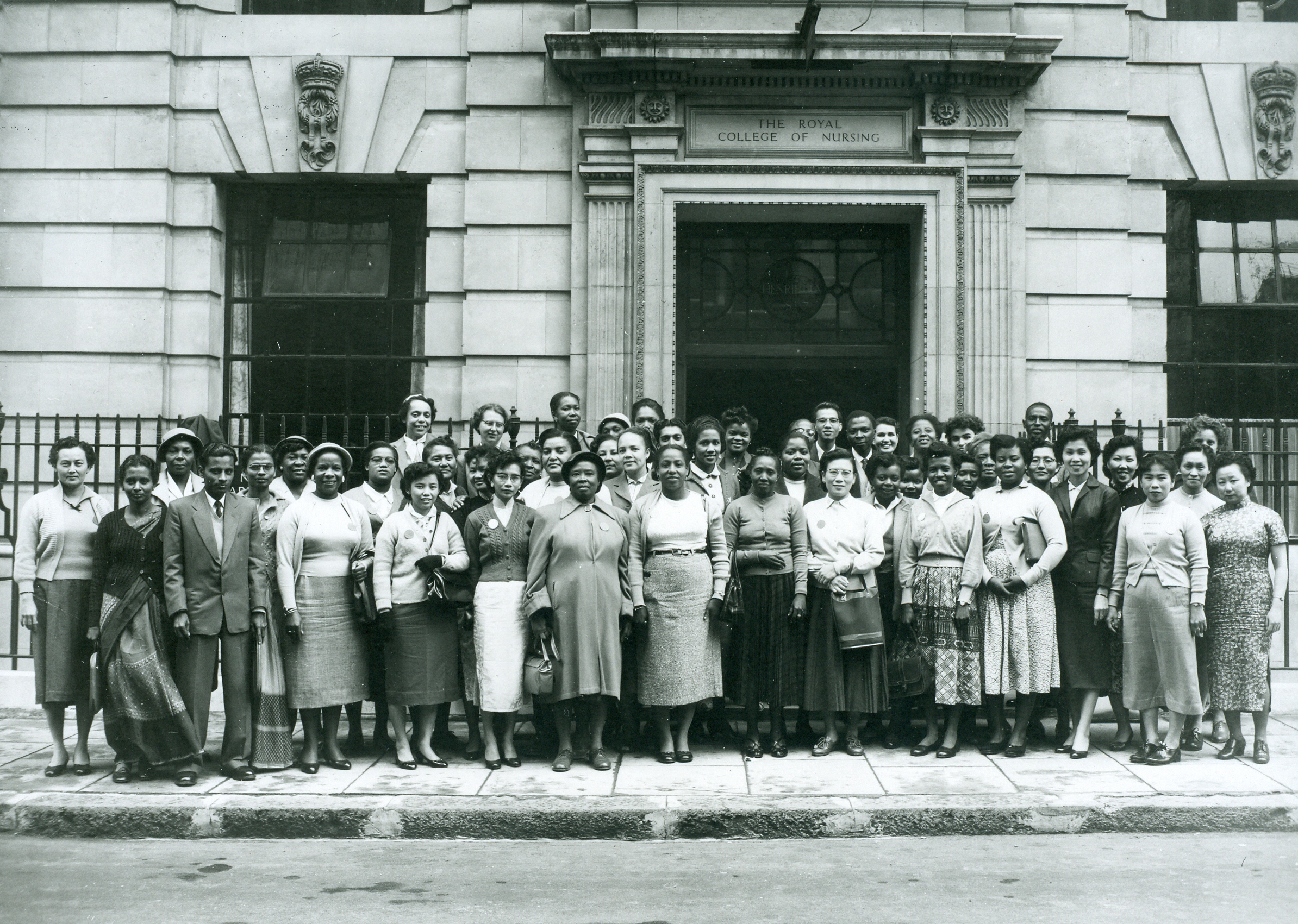 International School Students photographed outside the entrance to the Royal College of Nursing in 1957.