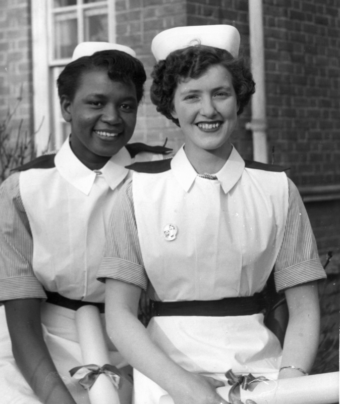 Two nurses on their graduation day in the 1950s.