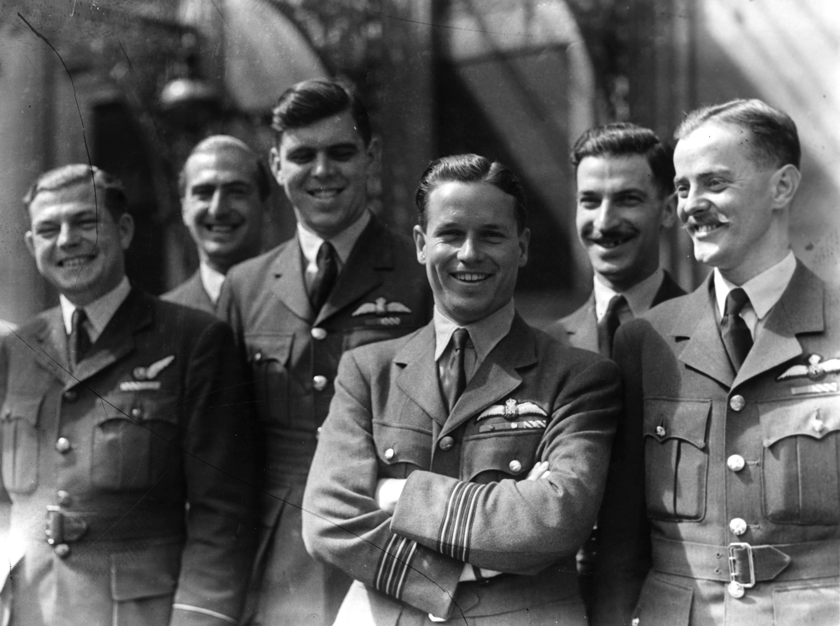 Guy Gibson (centre) with members of his squadron. (Photo by Keystone/Getty Images)