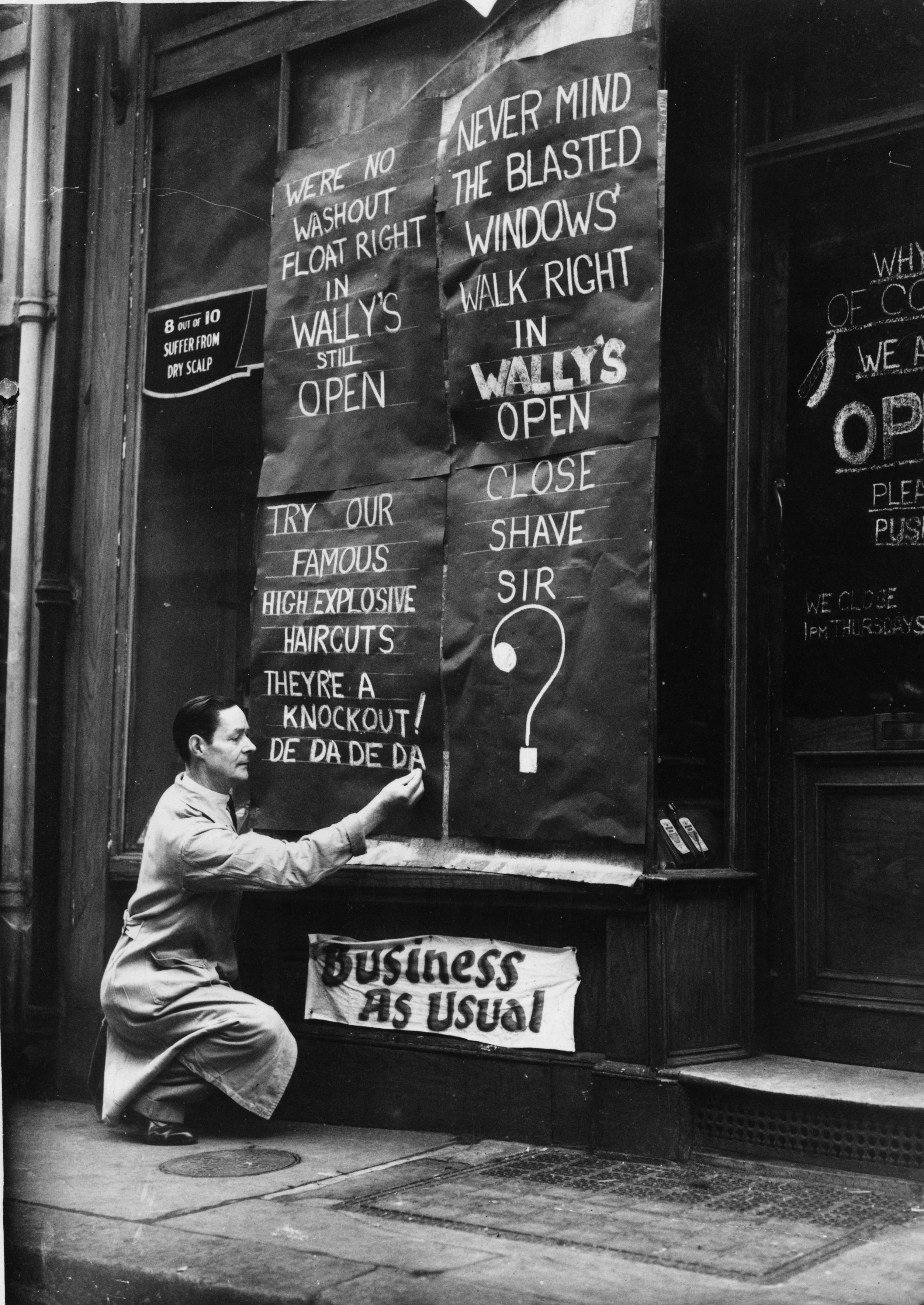 """""""Close shave sir?"""" A windowless Wally's barber shop in St Martin's Street shows its defiance during the London Blitz, November 1940. (Fox Photos/Getty Images)"""