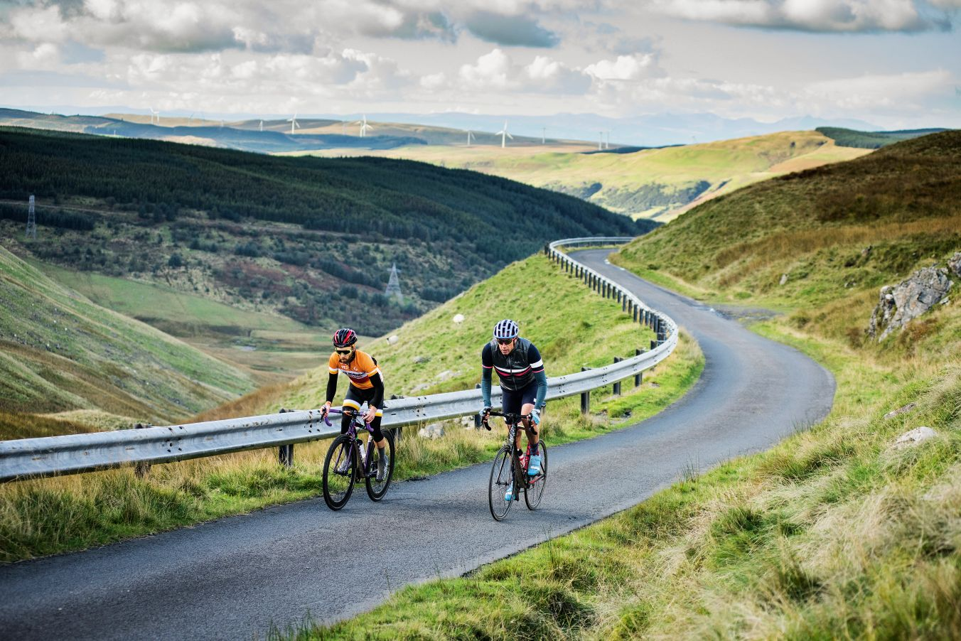 Two cyclists climbing in the Ayshire Alps