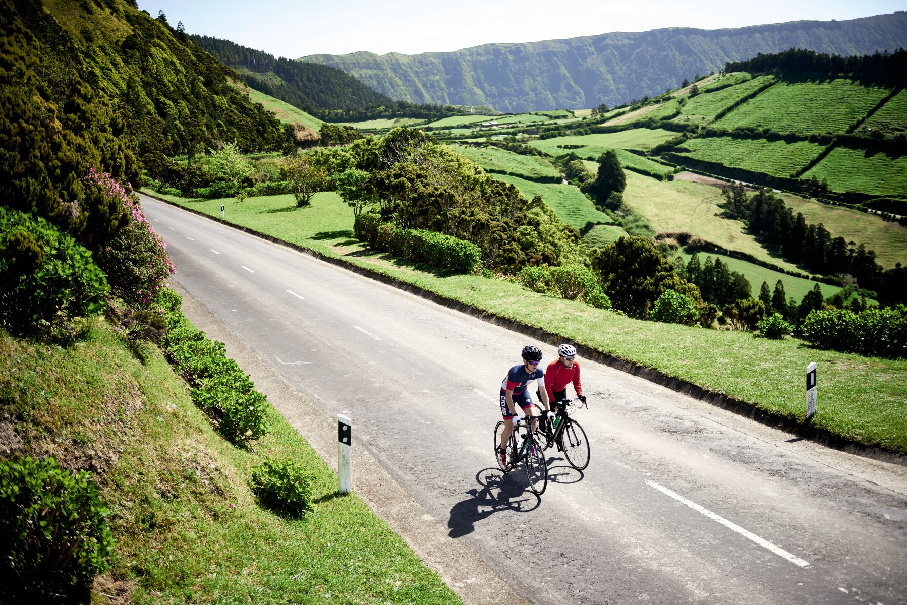 Two cyclists riding in the Azores