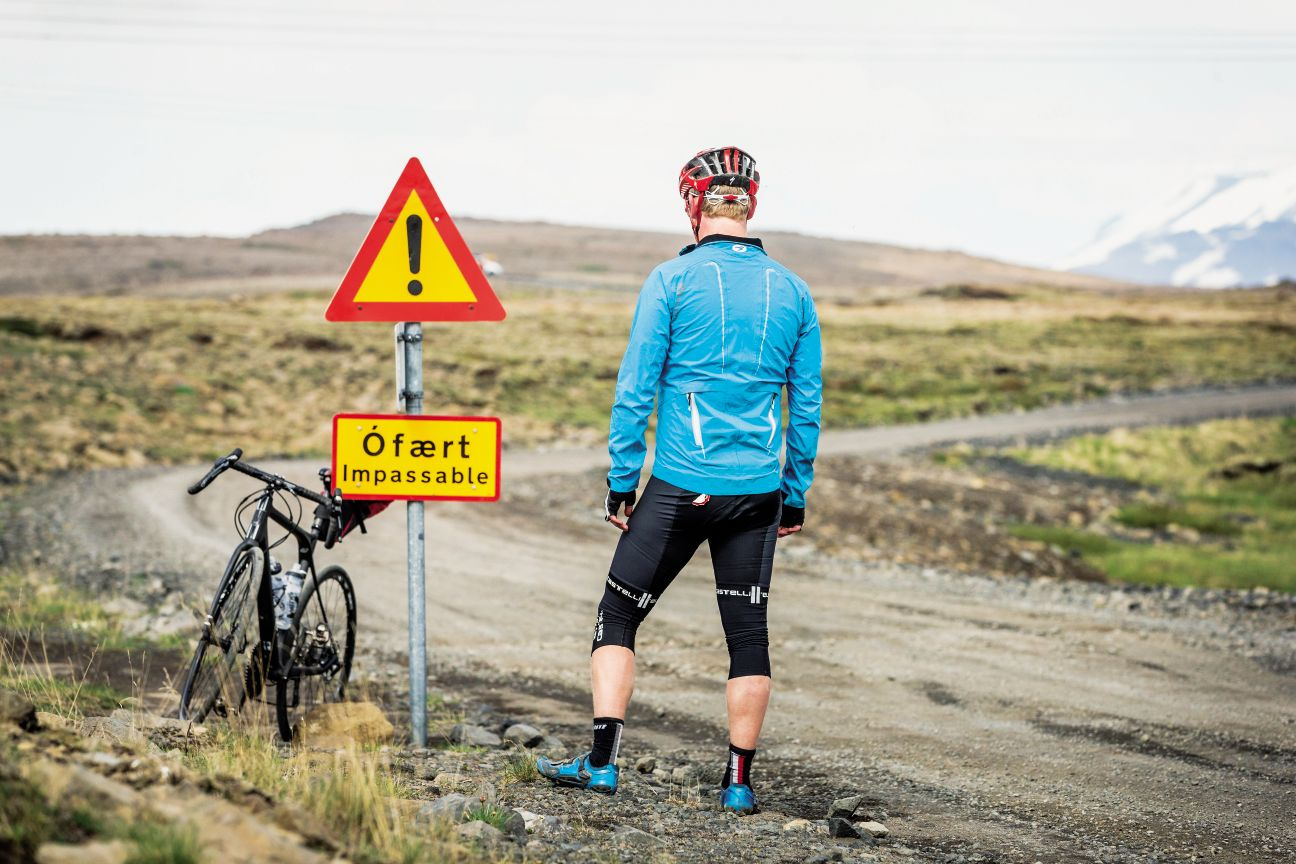 An Icelandic road sign and a cyclist