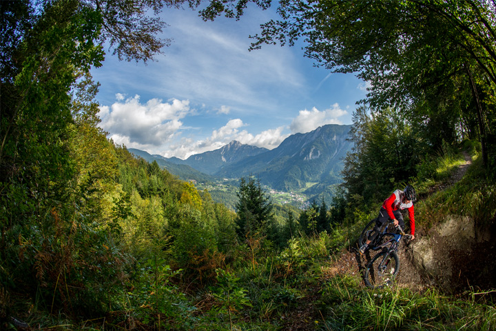 Singletrack in Slovenia with mountainous backdrop