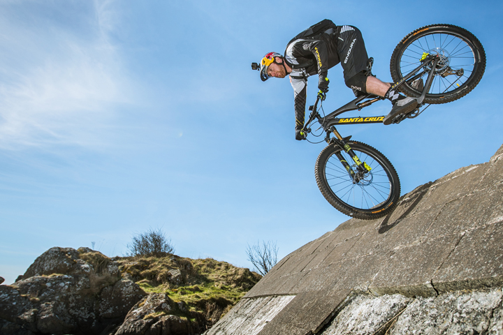 danny macaskill riding on front wheel down steep slope