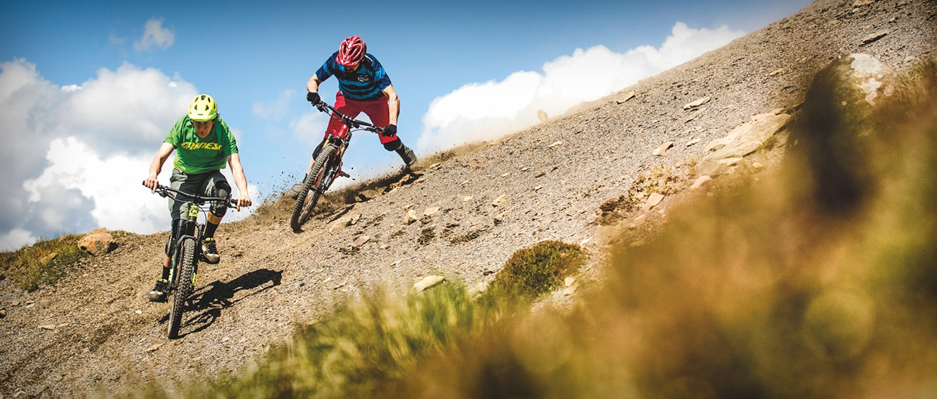 Two mountain bikers riding for MBUK