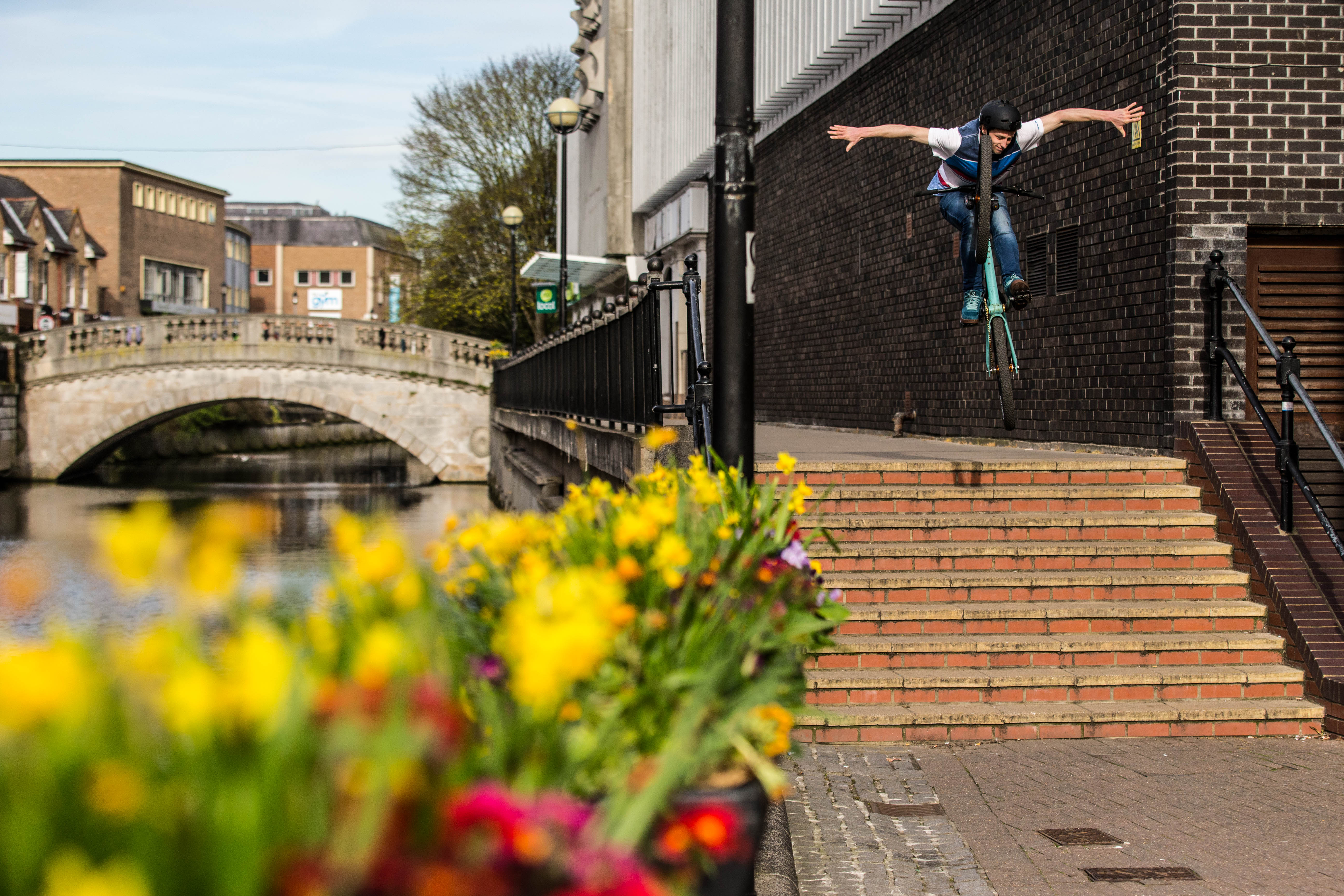 Tom Cardy has more skill than most, comfortably sending this set of stairs with a tuck no-hander! Credit: Simon Nieborak