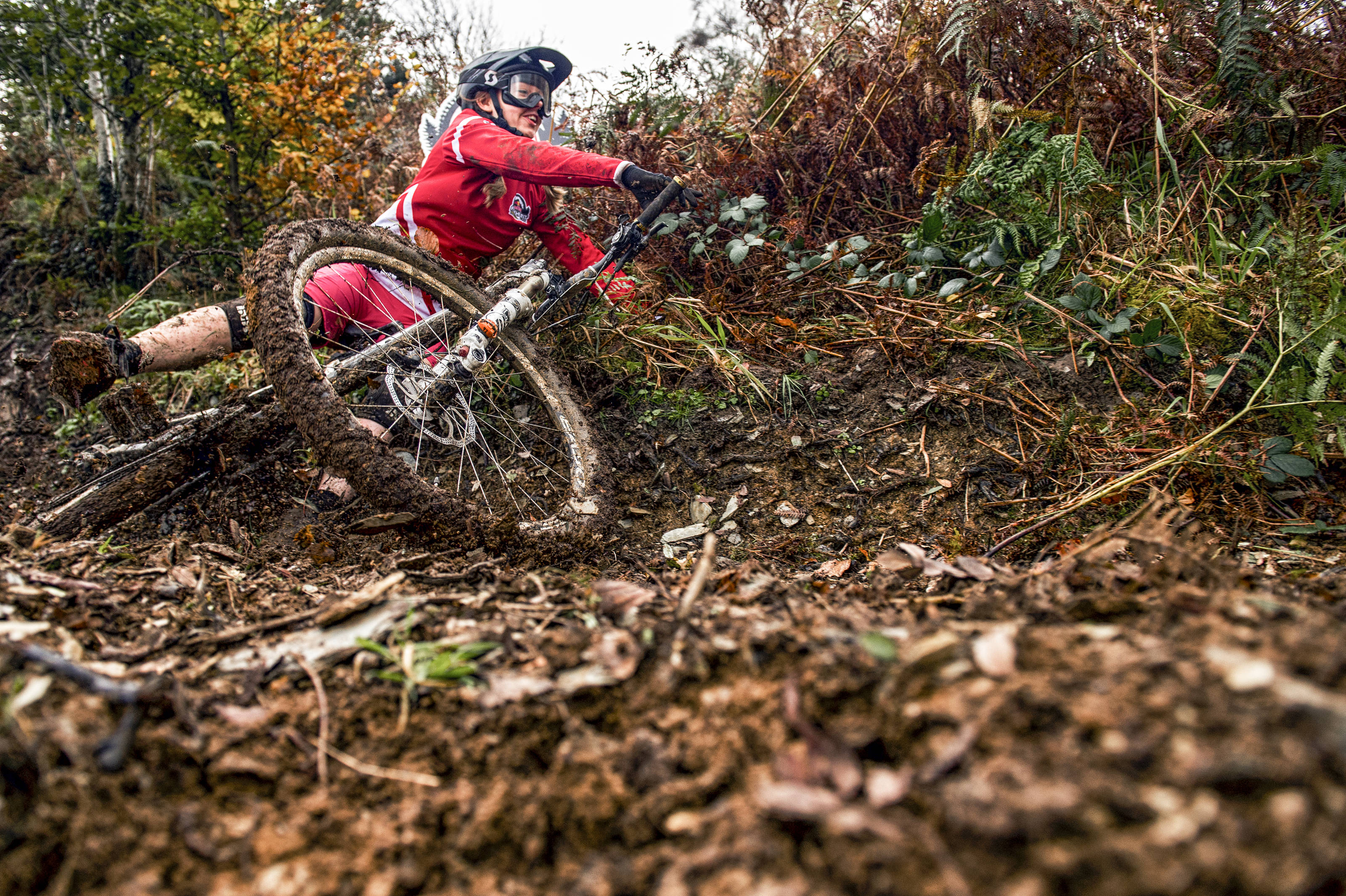 A rider crashes in the mud at the Red Bull Fox Hunt