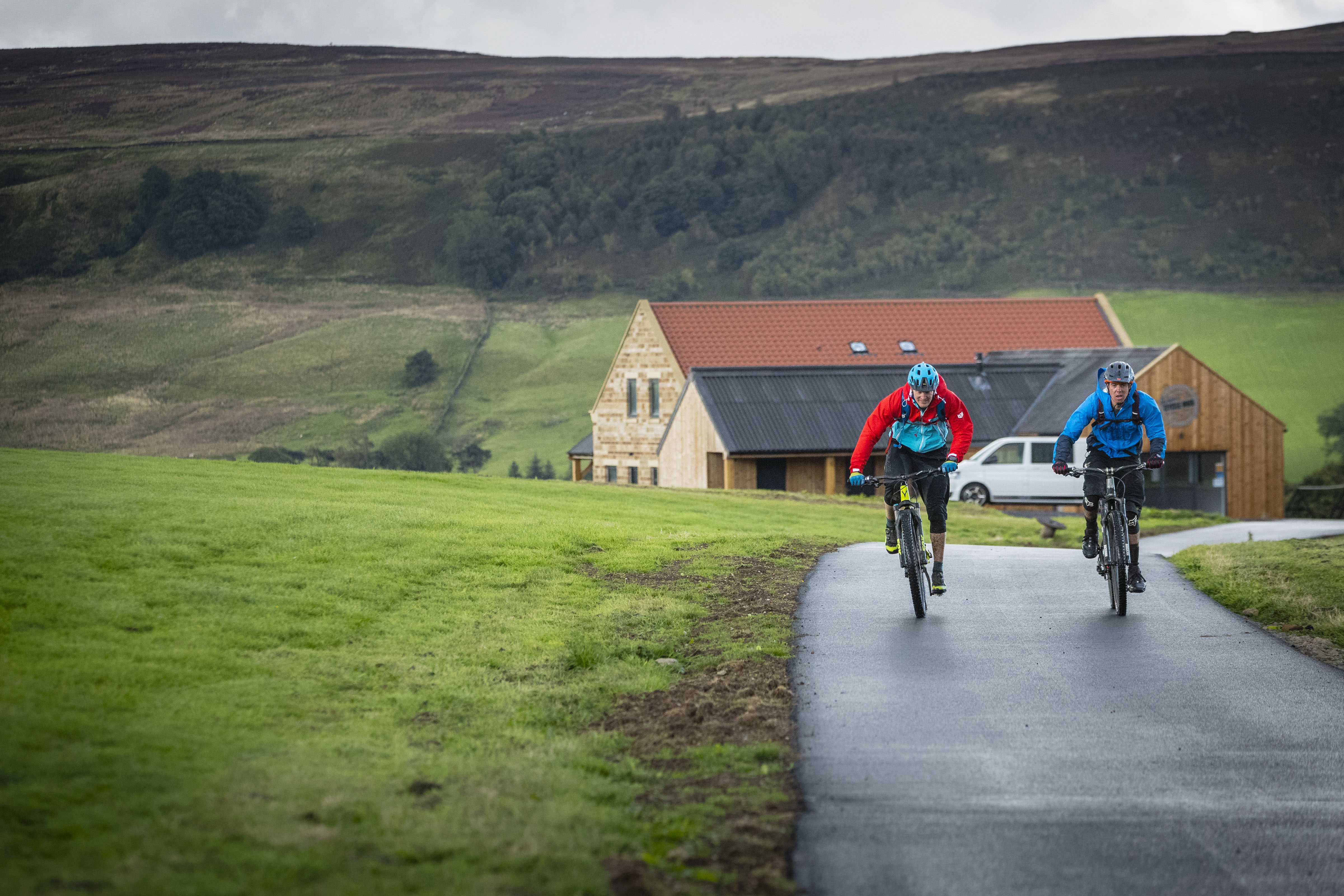Max Darkins and Phil Thurlow ride away from the Yorkshire Cycle Hub at the start of MBUK's big ride in the North York Moors