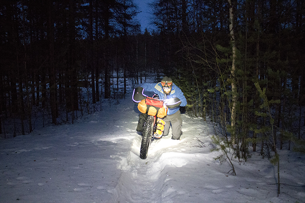 Pushing a bike through deep snow