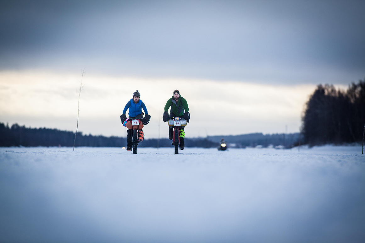 Matt and Tom Riding acros snow expanse in the Rovaniemi 150