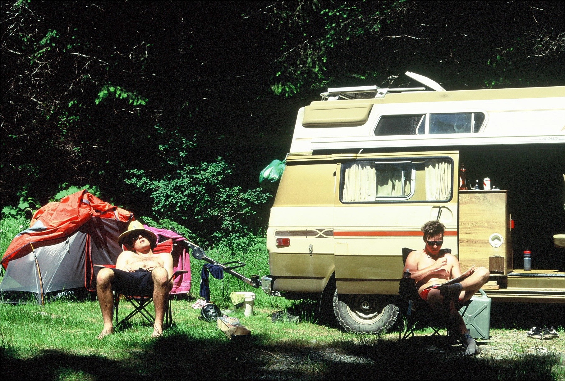 The Free Radicals hang out in front of their camper van